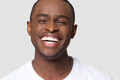 general dentistry man smiling white backdrop