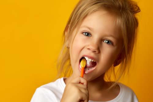pediatric dentistry young girl brushing teeth