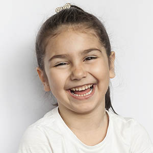 young girl laughing after family dentistry services in tx